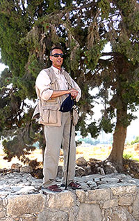 Youssef standing on Citadel of Amman Walls sharing information with tour group